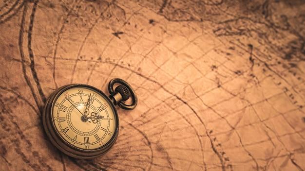 Watch pendant on world map