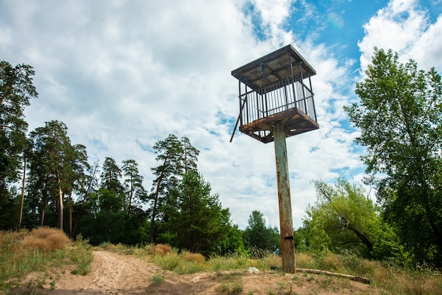 Watch tower in a beautiful landscape on sky backround