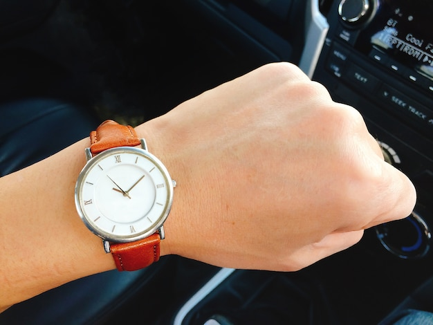 Watch on wrist in the car