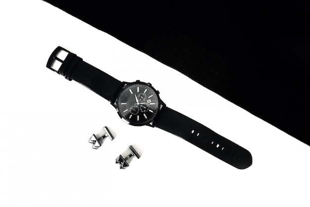 Watches and cufflinks on the table, black and white