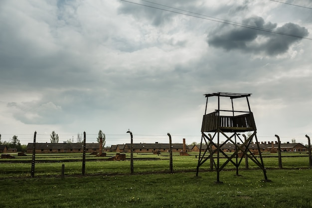 Watchtower and barbed wire fence, german concentration camp