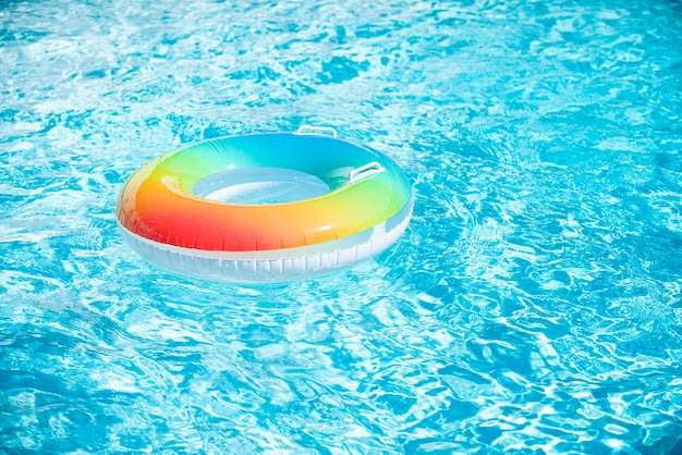 Water background. pool float, ring floating in a refreshing blue swimming pool. summer background.