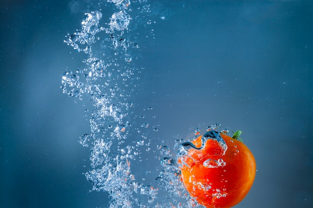 Water background with bubbles and tomato