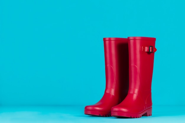 Water boots on blue background