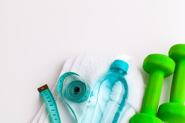 Water bottle and fitness equipment isolated