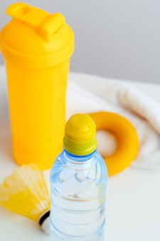 Water bottle and shaker bottle with protein