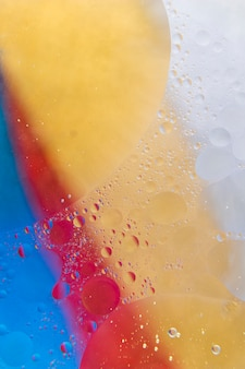 Water bubble drops on colorful paint backdrop