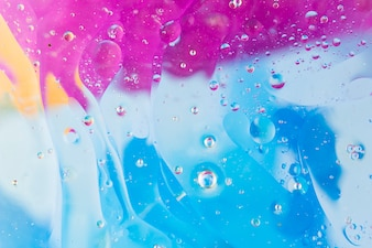 Water bubbles over the blue and pink background