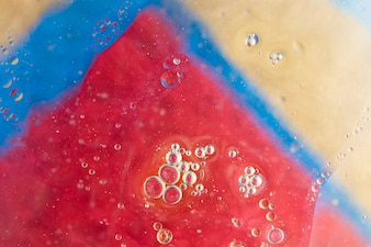 Water bubbles over the triangular painted colorful background