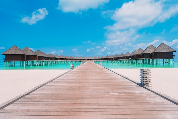 Water bungalows and wooden jetty on maldives