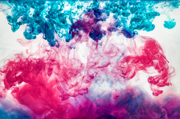 The water color ink movement explosion, abstract color background paint in water, liquid art