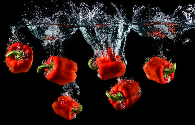 Water droping red bell pepper or paprika.