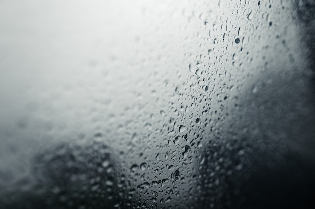 Water droplets on car windshield on rainy day