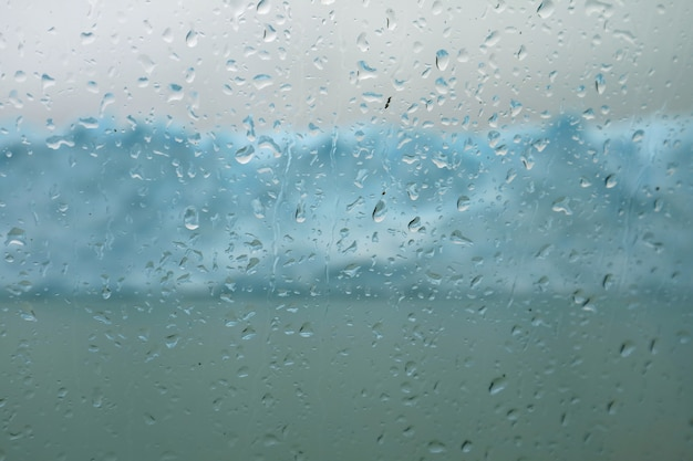 Water droplets on cruise ship glass window, perito moreno glacier, lake argentino, patagonia, argentina