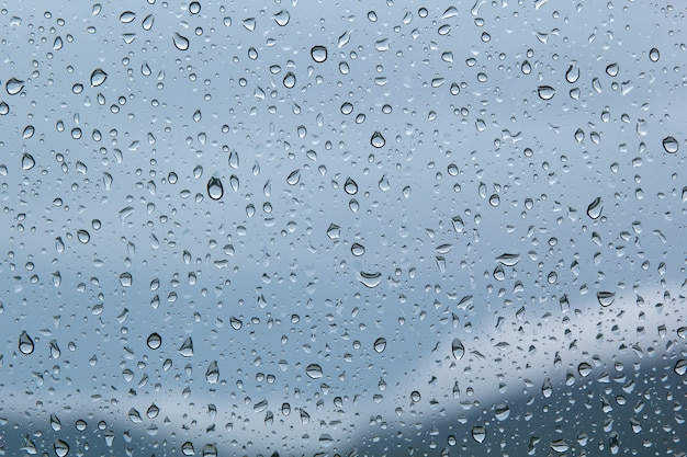 Water drops on car glassrain drops on clear window