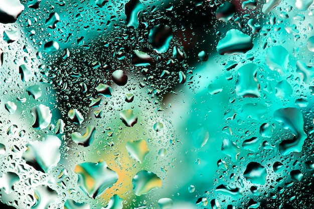 Water drops on colorful glass