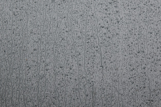 Water drops on gray glass