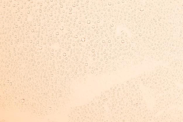 Water drops on orange background