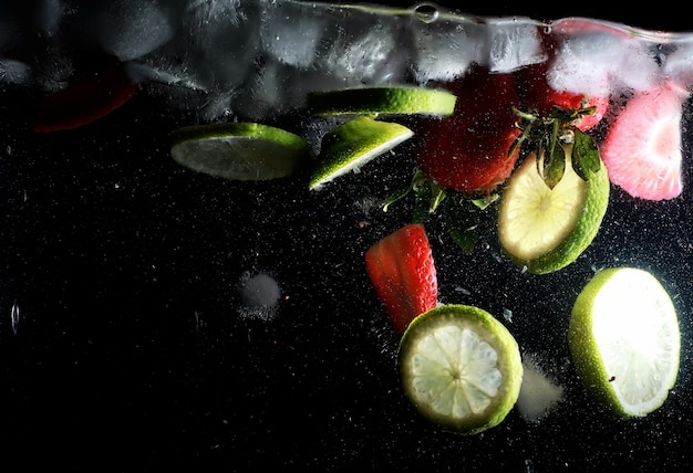 Water drops on ripe sweet fruits and berry. fresh fruits background with copy space for your text. vegan and vegetarian concept.