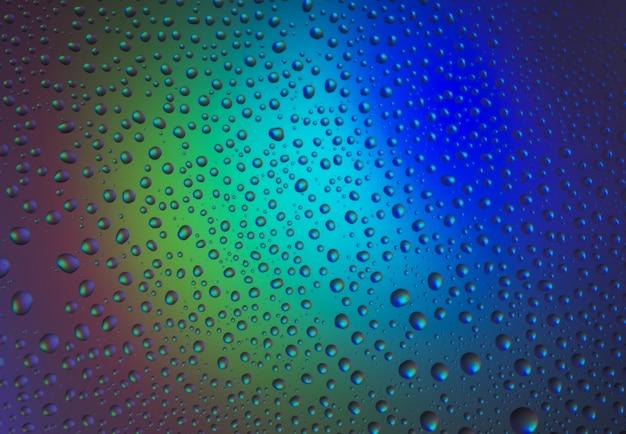 Капли воды с отражением радуги. светящаяся поверхность. фон