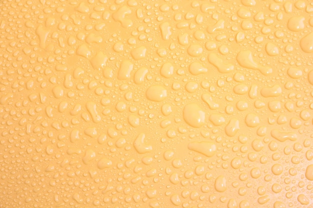 Water drops on a yellow background.