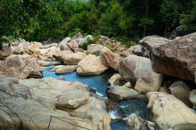 Water flowing in the middle of rocks at ba ho waterfalls cliff in vietnam