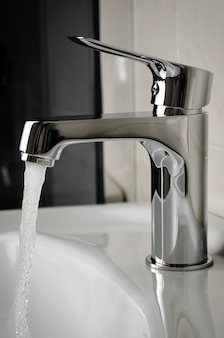Water flows from the tap or faucet in bathroom