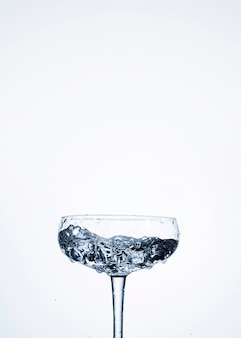 Water in glass with empty space