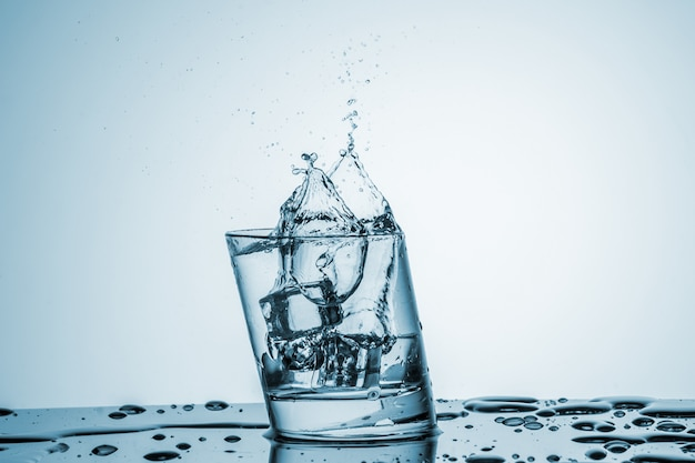 Water in glass with water splash