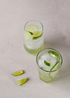 The water is mineral with lime and ice in transparent glasses. cold drink for the body's detox, a copy of the space