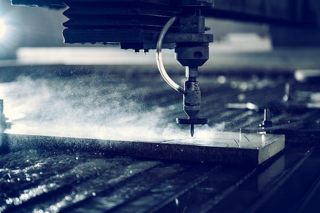 Water jet cutter machine cutting steel plate