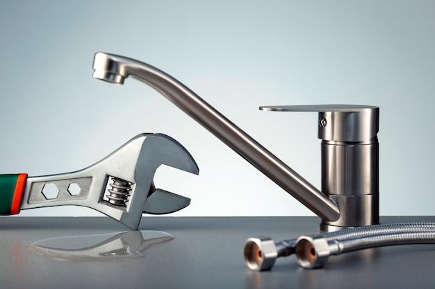 Water leak at faucet. concept repair water tap.
