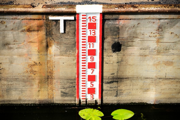 Water level gauge or water tide level measurement scale or water lever indicator.