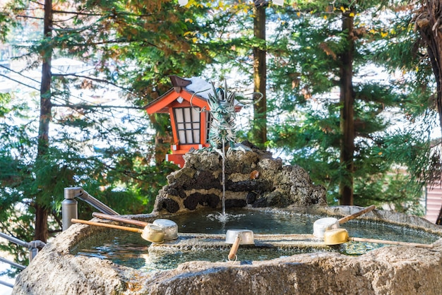 Water pond, tradition for hands washing before entering the temple in japan