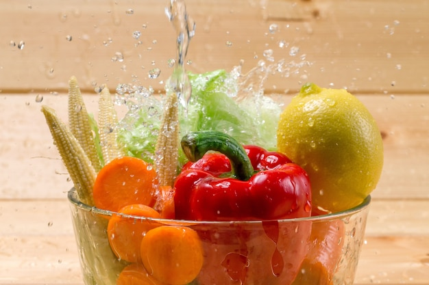 Water poured on fresh vegetables before cooking.
