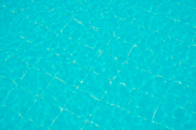 Water rippled on swimming pool water surface for background