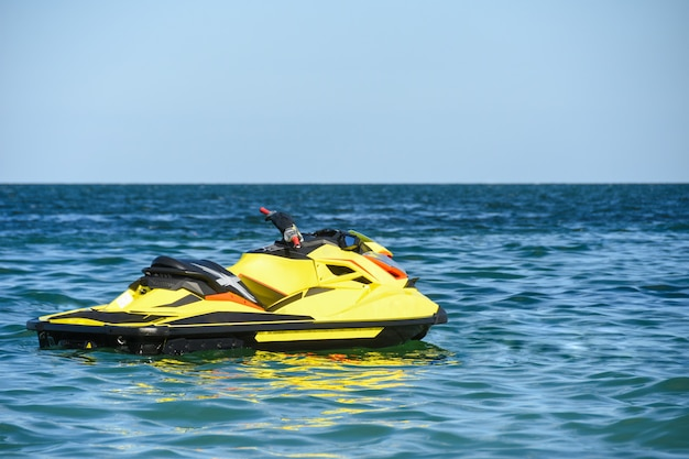 Water scooter floats on waves in sea water