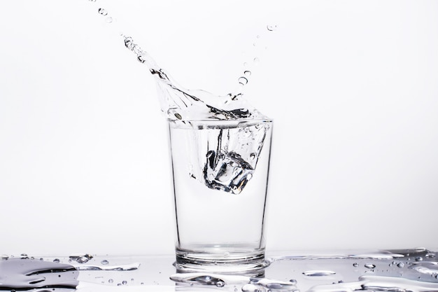 Water splashes in glass, isolated