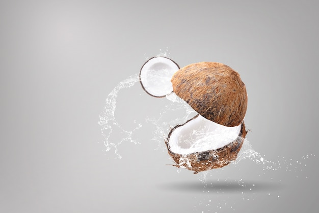Water splashing on coconuts on a white background