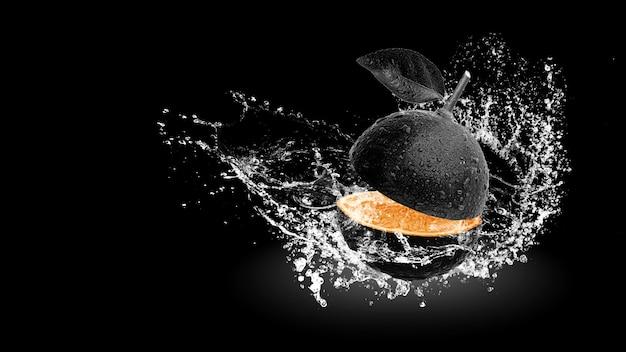Water splashing on fresh black lemon isolated on black background