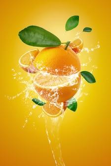 Water splashing on fresh sliced oranges and orange fruit on orange