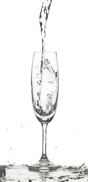 Water splashing into glass on white background