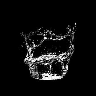 黒の背景に分離された水しぶき。 Premium写真
