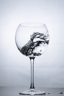 Water splashing in the luxury wine glass close up