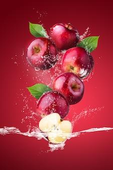 Брызги воды на свежие красные яблоки