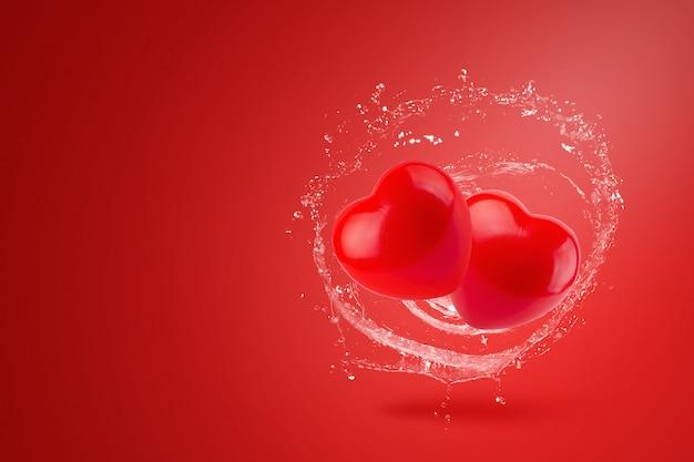 赤い背景に赤いハートにはねかける水。バレンタインデーのコンセプト。