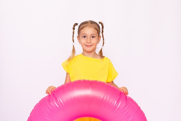 Water sport and children concept. cute small ginger child has summer beach vacation, orange life jacket for safe bathing in sea, has best holiday ever. joy, season, kids