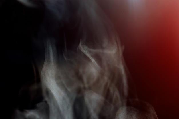 Water steam on dark background.