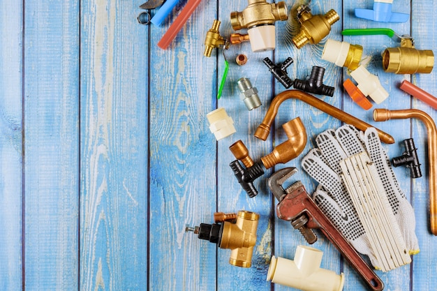 Water supply kit tools polypropylene pipes, plastic corners, wrench, work gloves on plumbing parts, accessories