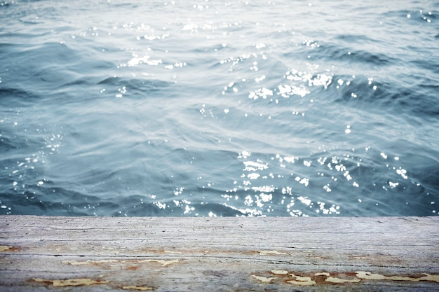 Water surface with wooden table in front